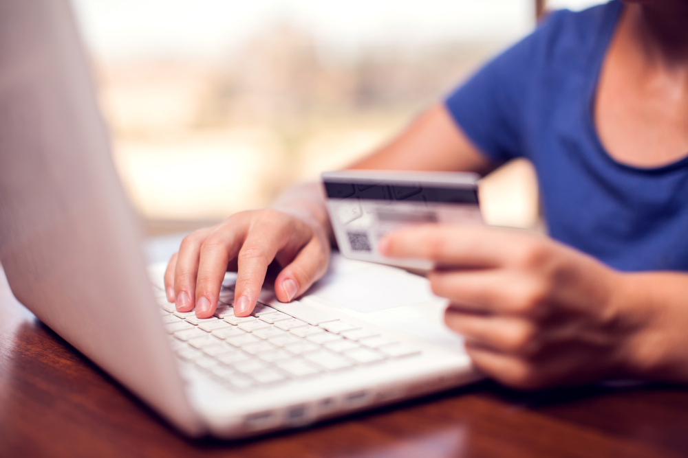Woman makes online payment with laptop.